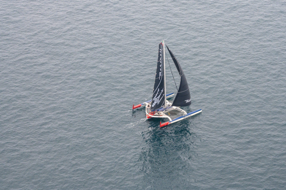 Maserati Multi 70 is sailing inside the depression with 3-6 knots of wind