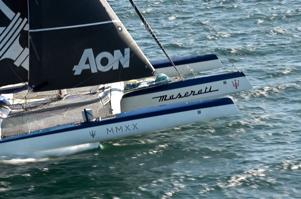 Maserati Multi 70 sails with tailwind behind LoveWater