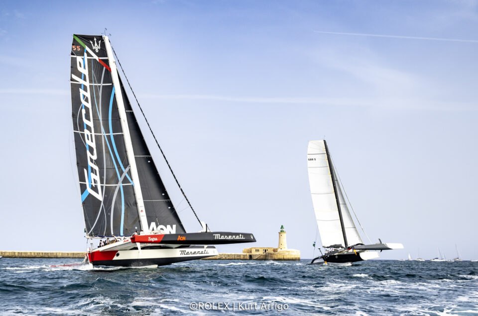 Maserati Multi 70 sails out of the Strait of Messina in the lead